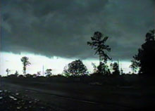 [ Gust front passes overhead of Hague - Screen grab from video ]